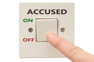 Turning off Accused with finger on electrical switch